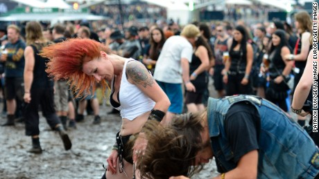WACKEN, GERMANY - AUGUST 03:  Music fans headbang at the Wacken Open Air heavy metal music fest on August 3, 2012 in Wacken, Germany. Approximately 75,000 heavy metal fans from all over the world have descended on the north German village of 1,800 residents for the annual three-day fest.  (Photo by Patrick Lux/Getty Images)