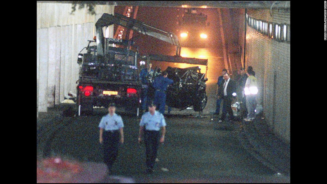 Wreckage is lifted away after the car Diana was in crashed into a pillar on August 31, 1997. Fayed and driver Henri Paul died at the scene. Diana died at a Paris hospital a few hours later. A French investigation concluded that Paul was legally drunk at the time and responsible for the accident. In 2008, a British coroner's jury found that Diana and Fayed were unlawfully killed because of the actions of Paul and pursuing paparazzi.