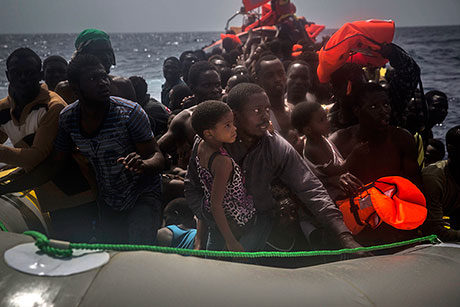 Migrants wait to be rescued by aid workers of Spanish NGO Proactiva Open Arms in the Mediterranean.