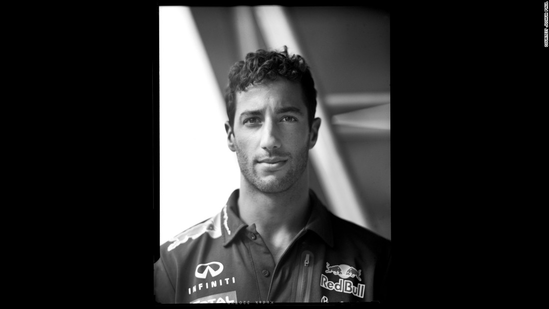 "The photographer singles out this portrait of Red Bull driver Daniel Ricciardo as his favorite. ""Daniel was very cool and very candid in front of the camera but he had this big smile on his face,"" Paul recalls. ""I was just <em>trying</em> to get him not to smile!"""