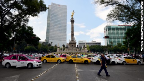 Taxi drivers take part in a protest against the private taxi company Uber for alleged unfair competition, in Mexico City on October 12, 2016.  Thousands of taxi drivers protested across the Mexican capital demanding the government to take action against Uber, while the company retaliates by offering free transport in the city. / AFP / ALFREDO ESTRELLA        (Photo credit should read ALFREDO ESTRELLA/AFP/Getty Images)