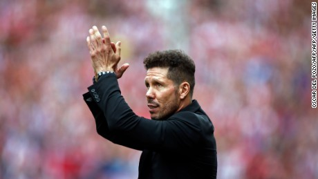 Atletico de Madrid's Argentinian coach Diego Pablo Simeone claps during a celebration bidding farewell to the team's stadium after the Spanish league football match Club Atletico de Madrid vs Athletic Club Bilbao at the Vicente Calderon stadium in Madrid on May 21, 2017. Atletico Madrid's mythical Vicente Calderon stadium will soon be history: sad news for supporters of Real Madrid's rivals but not so for locals who hope the neighbourhood will improve once noisy fans are gone. This weekend spells the end for the ageing structure that for over 50 years has housed Atletico Madrid -- not as well known abroad as the world-famous Real Madrid despite fielding players like French star Antoine Griezmann but with a huge following in the Spanish capital.   / AFP PHOTO / OSCAR DEL POZO        (Photo credit should read OSCAR DEL POZO/AFP/Getty Images)