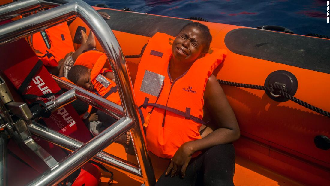 "A woman cries <a href=""http://www.cnn.com/2017/07/26/europe/migrant-crisis-mediterranean/index.html"" target=""_blank"">after being rescued</a> in the Mediterranean Sea about 15 miles north of Sabratha, Libya, on July 25, 2017. More than 6,600 migrants and refugees entered Europe by sea in January 2018, <a href=""https://www.iom.int/news/90-migrants-reportedly-drown-bodies-wash-libyan-shores"" target=""_blank"">according to the UN migration agency</a>, and more than  240 people died on the Mediterranean Sea during that month."