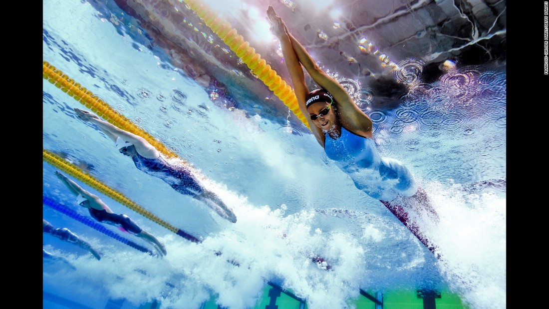 "And visit <a href=""http://edition.cnn.com/specials/sport/swimming"">CNN.com/specials/sport/swimming</a> for the latest news and features."