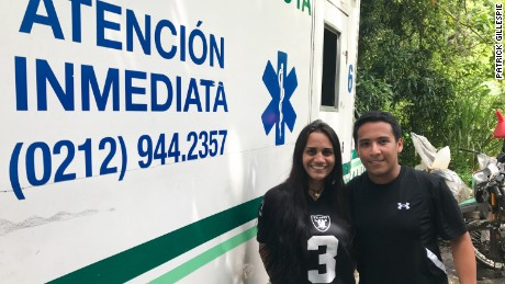 Medics Genesis Franceschi, 25, and Jose Viera, 20, are volunteer to aid the wounded during Venezuela's violent protests in Caracas.