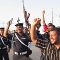 Iraqi police celebrate football guns