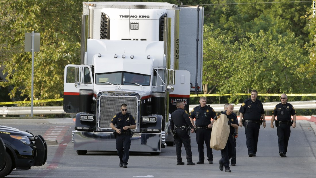 "San Antonio police officers investigate the scene where <a href=""http://www.cnn.com/2017/07/26/us/texas-migrant-trailer-deaths-timeline/index.html"" target=""_blank"">dozens of undocumented immigrants were found in a parked tractor-trailer truck</a> on Sunday, July 23. Eight people in the truck were already dead, and two more died after being hospitalized. Others were severely injured, and many will suffer from ""irreversible brain damage,"" the city's fire chief said. The truck's driver was charged with knowingly transporting undocumented immigrants."