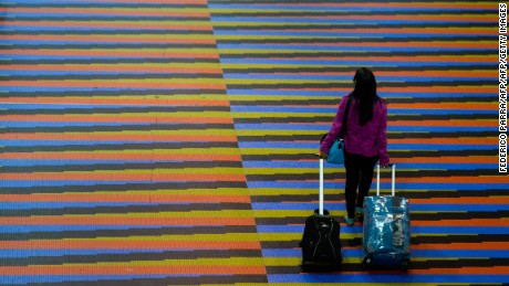 A passenger walks at Simon Bolivar international airport in Caracas, on June 17, 2016. German airline Lufthansa suspended flights to crisis-hit Venezuela for an indefinite period as of today owing to the economic crisis in the country. The service, three times a week, was Lufthansa's only flight between Germany and Venezuela. Currency controls in Venezuela make it impossible for airlines to convert their earnings into dollars and send the money abroad.  / AFP / FEDERICO PARRA        (Photo credit should read FEDERICO PARRA/AFP/Getty Images)