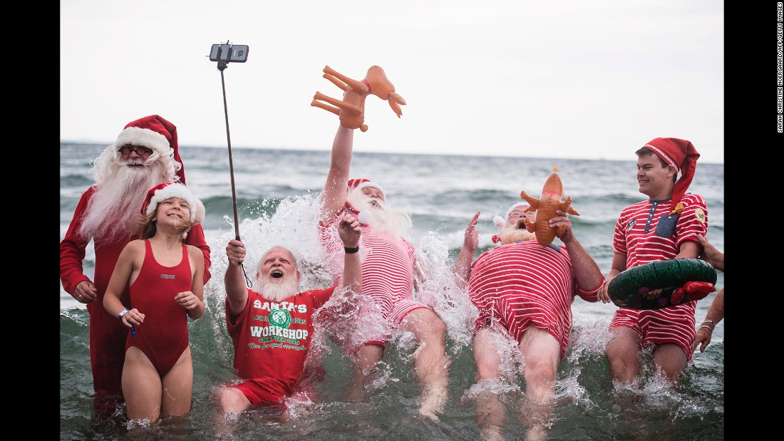 People dressed as Santa Claus take a photo Tuesday, July 25, during the World Santa Claus Congress in Klampenborg, Denmark. The annual conference brings together professional Santas from all over the world.