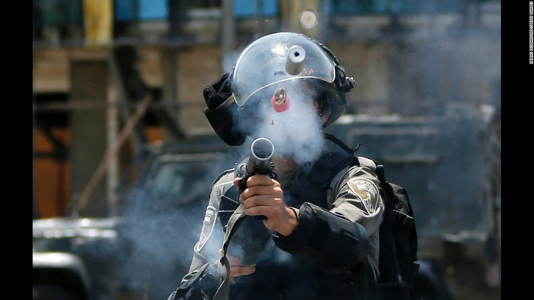 "An Israeli border guard fires a tear-gas canister toward Palestinian protesters Monday, July 24, during clashes near the Jewish settlement of Beit El in the West Bank. There has been increased tension in the region after Israel installed metal detectors at the al-Aqsa mosque in Jerusalem earlier this month. Israel, which implemented the security measure after an attack that killed two Israeli police officers, <a href=""http://www.cnn.com/2017/07/24/middleeast/israeli-embassy-jordan/index.html"" target=""_blank"">removed the detectors</a> this week."