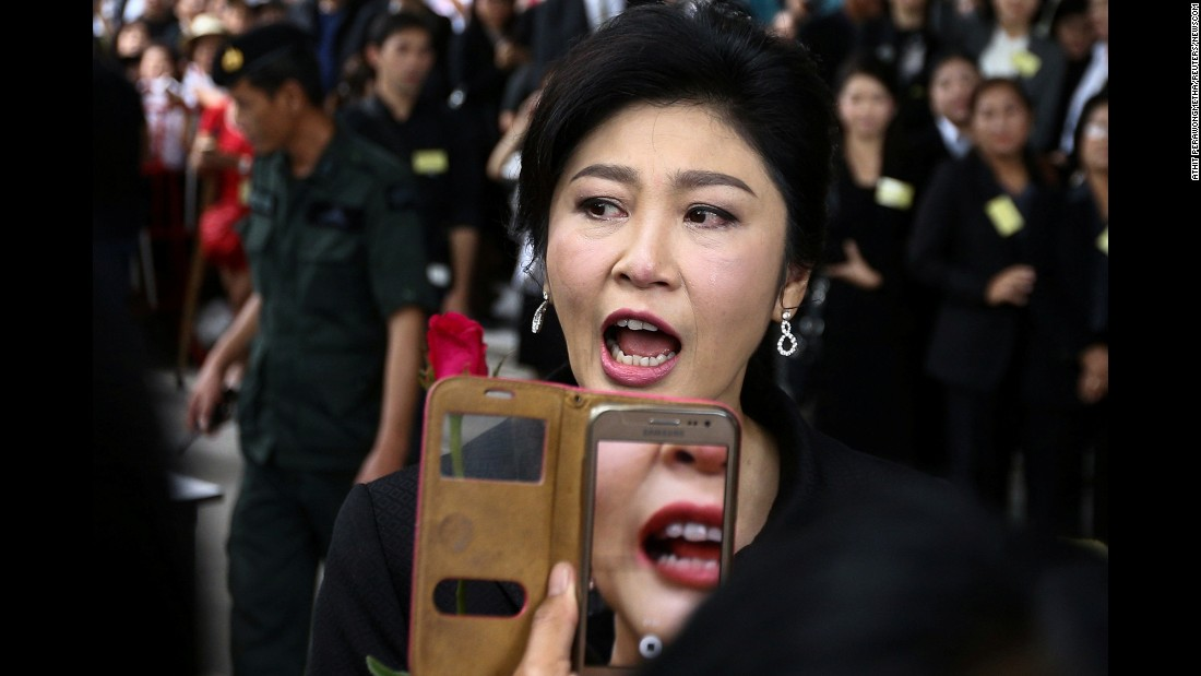 "Yingluck Shinawatra, the former prime minister of Thailand, greets supporters as she arrives at the Supreme Court in Bangkok on Friday, July 21. <a href=""http://www.cnn.com/2015/01/22/world/thailand-yingluck-shinawatra-court/index.html"" target=""_blank"">She faces criminal charges</a> over a controversial rice subsidy program that cost the country billions. She is fighting the charges, saying they are politically motivated."