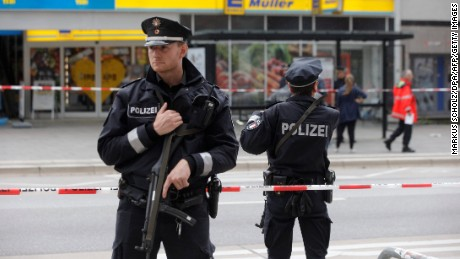"Police cordon off the area around a supermarket in the northern German city of Hamburg, where a man killed one person and wounded several others in a knife attack, on July 28, 2017.  ""There is no valid information yet on the motive or the number of people injured"" by the man, who ""entered a supermarket and suddenly began attacking customers"", said police, adding that one victim died from his severe wounds. / AFP PHOTO / dpa / Markus Scholz / Germany OUT        (Photo credit should read MARKUS SCHOLZ/AFP/Getty Images)"
