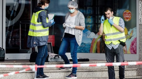 Police officers secure evidence at a supermarket Friday in Hamburg, Germany, after a knifing attack.