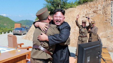 "TOPSHOT - This picture taken on July 4, 2017 and released by North Korea's official Korean Central News Agency (KCNA) on July 5, 2017 shows North Korean leader Kim Jong-Un (C) celebrating the successful test-fire of the intercontinental ballistic missile Hwasong-14 at an undisclosed location. South Korea and the United States fired off missiles on July 5 simulating a precision strike against North Korea's leadership, in response to a landmark ICBM test described by Kim Jong-Un as a gift to ""American bastards"". / AFP PHOTO / KCNA VIA KNS / STR / South Korea OUT / REPUBLIC OF KOREA OUT   ---EDITORS NOTE--- RESTRICTED TO EDITORIAL USE - MANDATORY CREDIT ""AFP PHOTO/KCNA VIA KNS"" - NO MARKETING NO ADVERTISING CAMPAIGNS - DISTRIBUTED AS A SERVICE TO CLIENTS THIS PICTURE WAS MADE AVAILABLE BY A THIRD PARTY. AFP CAN NOT INDEPENDENTLY VERIFY THE AUTHENTICITY, LOCATION, DATE AND CONTENT OF THIS IMAGE. THIS PHOTO IS DISTRIBUTED EXACTLY AS RECEIVED BY AFP.    /         (Photo credit should read STR/AFP/Getty Images)"