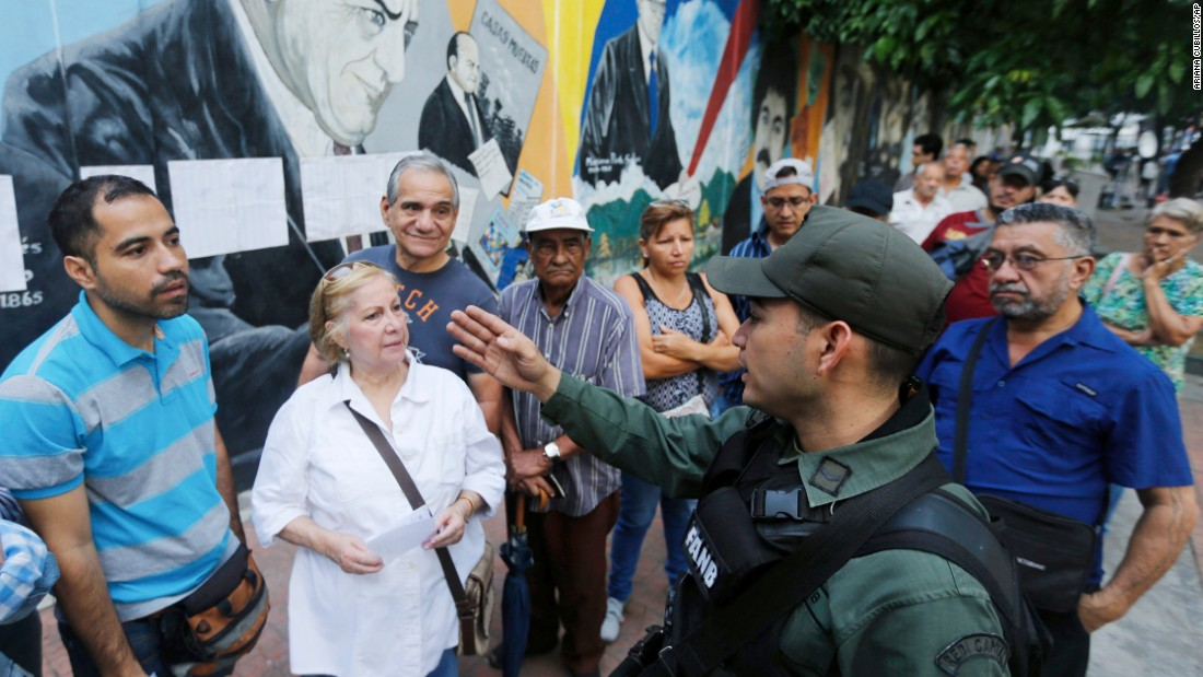 Voters receive instructions from a Venezuelan Bolivarian National Guard officer outside a polling station in Caracas.