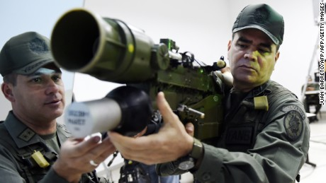 "Venezuelan Defense Minister Vladimir Padrino Lopez (R) mans a Russian-made 9K338 ""Igla-S"" (SA-18) man-portable air-defence  (MANPAD) surface-to-air missile launcher in Caracas on March 14, 2015. A hundred thousand men, with Chinese-made anphibious vehicles and Russian missiles are taking part in military drills ordered by President  Nicolas Maduro to prepare the country to face the ""unusual threat"" to its security.  AFP   PHOTO/JUAN BARRETO        (Photo credit should read JUAN BARRETO/AFP/Getty Images)"