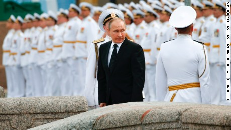 Russian President Vladimir Putin attends a ceremony for Russia's Navy Day in Saint Petersburg on July 30, 2017. President Vladimir Putin oversaw a pomp-filled display of Russia's naval might as the Kremlin paraded its sea power from the Baltic Sea to the shores of Syria.  Some 50 warships and submarines were on show along the Neva River and in the Gulf of Finland off the country's second city of Saint Petersburg after Putin ordered the navy to hold its first ever parade on such a grand scale.  / AFP PHOTO / POOL / Alexander Zemlianichenko        (Photo credit should read ALEXANDER ZEMLIANICHENKO/AFP/Getty Images)