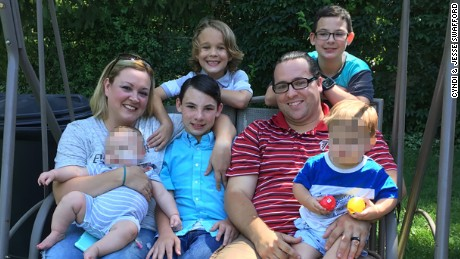 Cyndi and Jesse Swafford, shown with their foster, adopted and biological children. CNN obscured a portion of this image to protect the identities of two foster children.