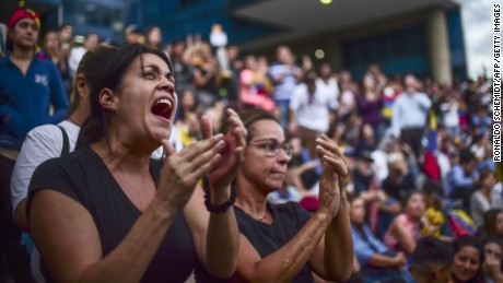 "Venezuelans protest against President Nicolas Maduro, in Caracas, on July 31, 2017. Venezuela's attorney general Luisa Ortega, a vocal dissenter in President Nicolas Maduro's government, said Monday she will not recognize a new assembly voted in on the weekend, calling it an expression of ""dictatorial ambition."" / AFP PHOTO / RONALDO SCHEMIDT        (Photo credit should read RONALDO SCHEMIDT/AFP/Getty Images)"