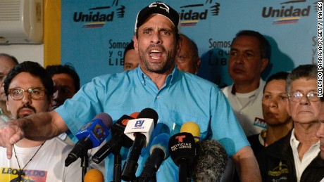 Venezuelan opposition leader and Miranda state governor Henrique Capriles (C) and members of the opposition coalition Democratic Unity Roundtable (MUD), offer a press conference in Caracas, on July 30, 2017. Venezuela's opposition called for new protests Monday and Wednesday against the inauguration of a powerful new assembly that embattled President Nicolas Maduro has tasked with writing a new constitution. / AFP PHOTO / FEDERICO PARRA        (Photo credit should read FEDERICO PARRA/AFP/Getty Images)