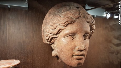 A sculpted clay head seized in the raids of the antiquities dealers' homes and businesses.