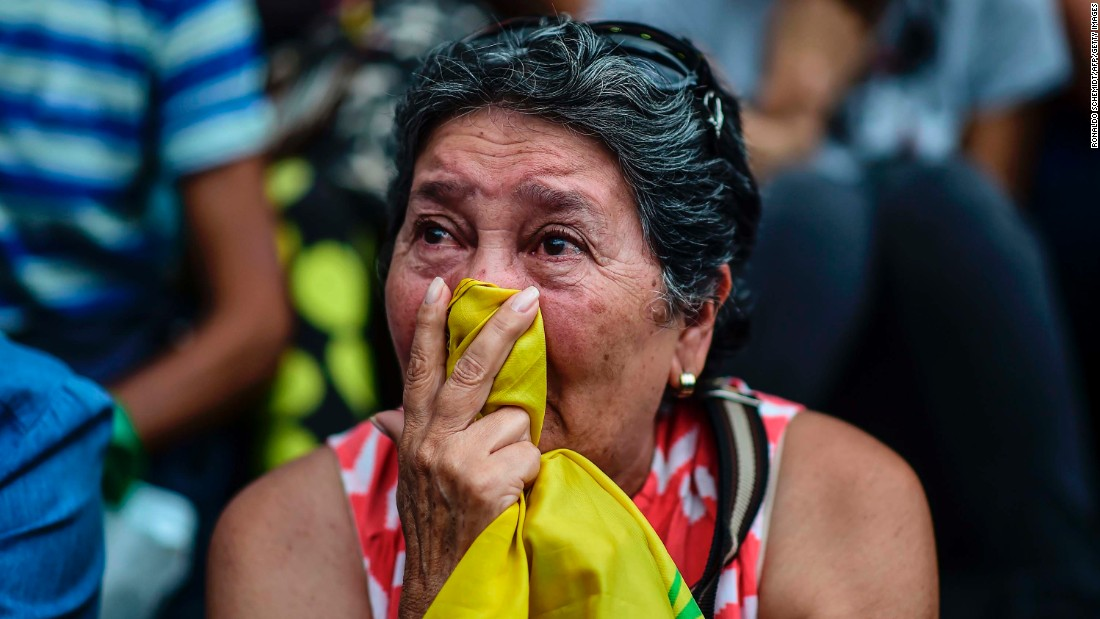 "A woman in Caracas attends a vigil Monday, July 31, for anti-government activists who have died in the country's recent unrest. <a href=""http://www.cnn.com/2017/08/01/americas/venezuela-election-unrest/index.html"">More than 120 people have been killed in Venezuela </a>since early April, according to the attorney general's office."
