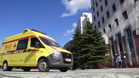 An ambulance arrives at the Moscow Region Court after gangsters opened fire Tuesday.