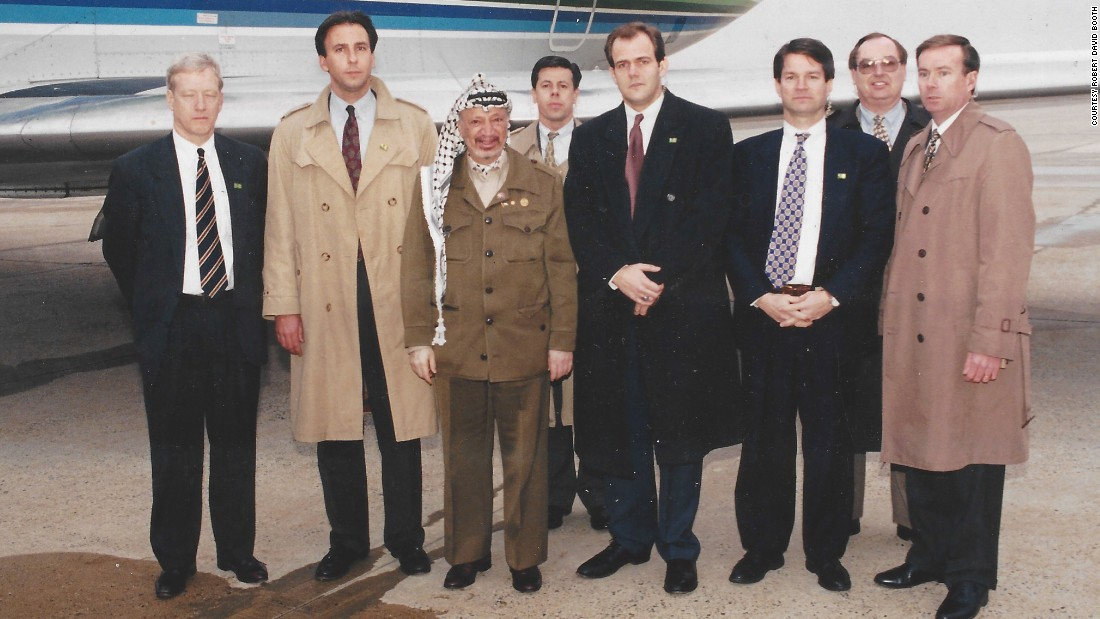 In the late 1990s, Booth, third from the right, was assigned to protect Palestinian leader Yasser Arafat, shown here shortly before his departure outside Washington, D.C., at what was then Andrews Air Force Base in Maryland.