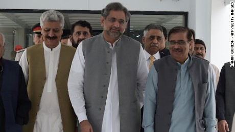 Prime Minister Shahid Khaqan Abbasi, center, leaves a meeting on August 1.