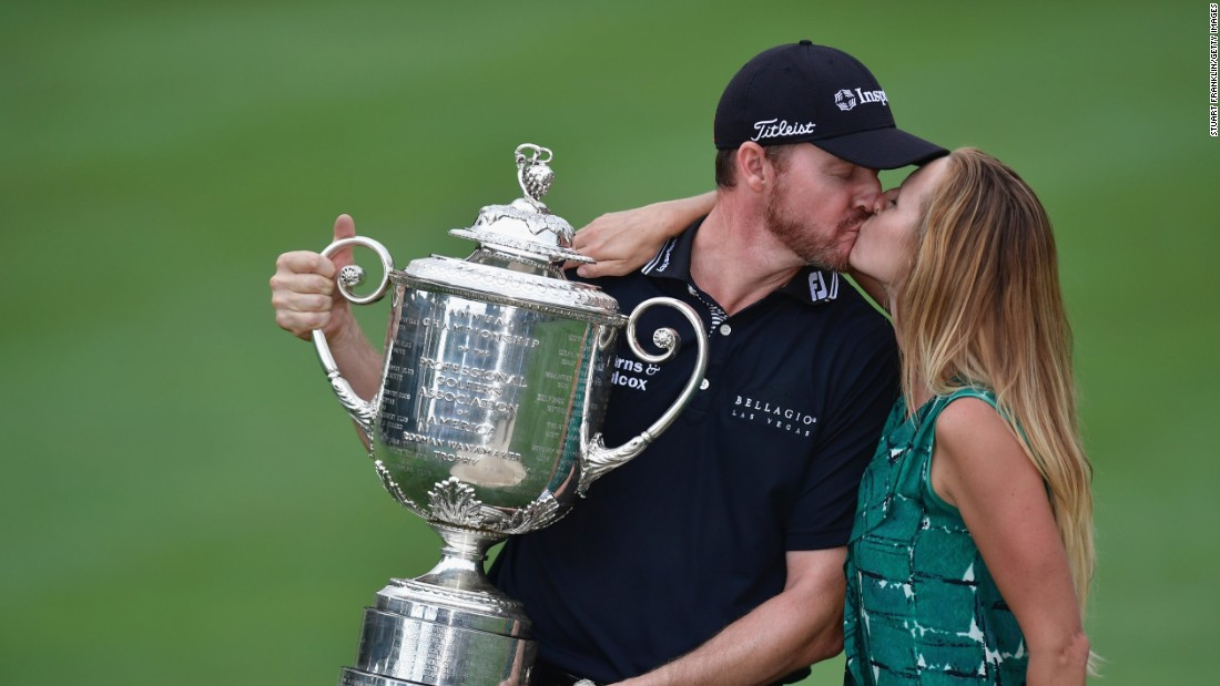 Erin Walker kisses husband Jimmy Walker after he claimed the US PGA Championship in 2016. She spends 30 weeks of the year traveling the world as he participates on the PGA Tour.