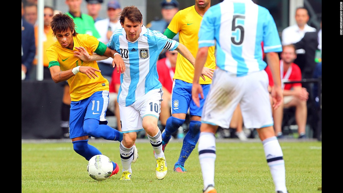 Neymar battles Argentina's Lionel Messi during an international friendly in June 2012. The two would later become teammates at Barcelona.