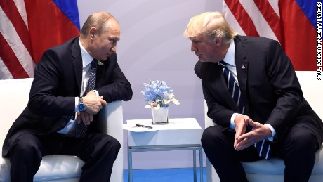 Russian President Vladimir Putin, left, with US President Donald Trump at the G20 Summit in Hamburg, Germany, on July 7, 2017.