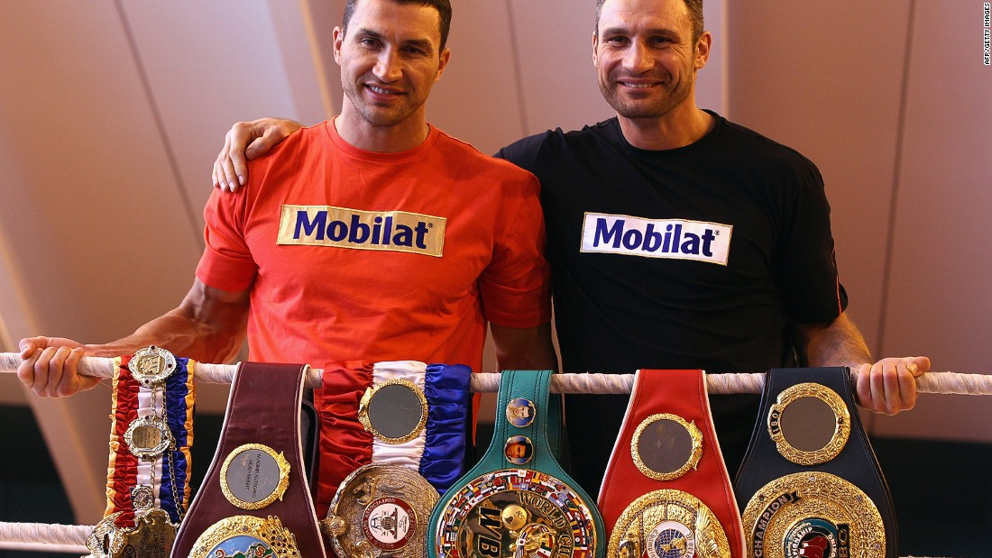 Klitschko (left) and brother Vitali pose with their championship belts in 2012.