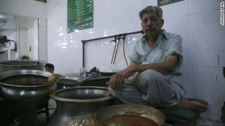 Gul Ahmed Ali has been dishing out food since childhood. He's a symbol of the city's obsession with food.