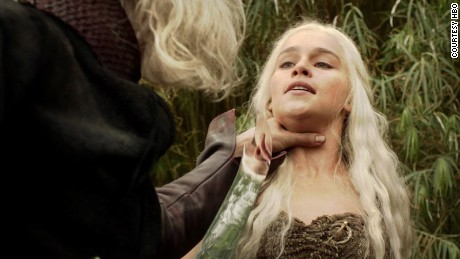 Daenerys is threatened by her brother in Season 1 after he sells her to her new husband.