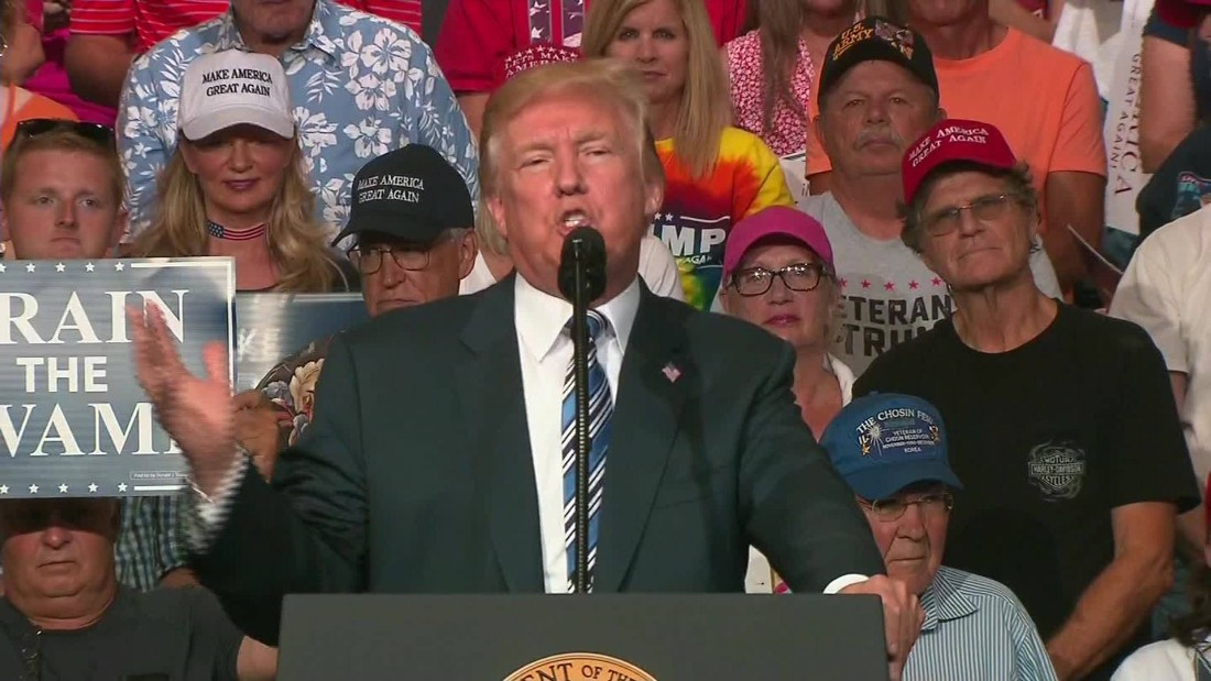 As investigation intensifies, Trump crows to crowd