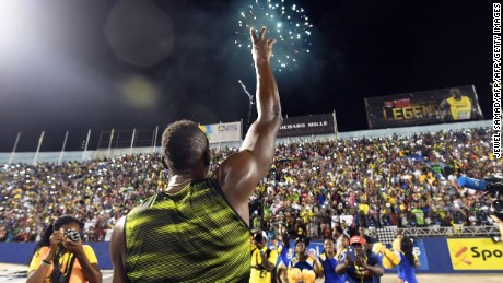 "Usain Bolt of Jamaica salutes the crowd after winning 100m ""Salute to a Legend "" race during the Racers Grand Prix at the national stadium in Kingston"