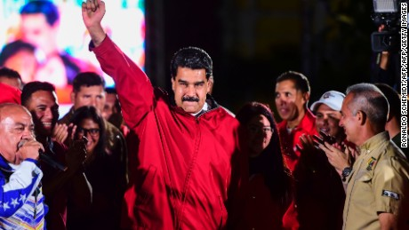 "TOPSHOT - Venezuelan president Nicolas Maduro celebrates the results of ""Constituent Assembly"", in Caracas, on July 31, 2017. Deadly violence erupted around the controversial vote, with a candidate to the all-powerful body being elected shot dead and troops firing weapons to clear protesters in Caracas and elsewhere.  / AFP PHOTO / RONALDO SCHEMIDT        (Photo credit should read RONALDO SCHEMIDT/AFP/Getty Images)"