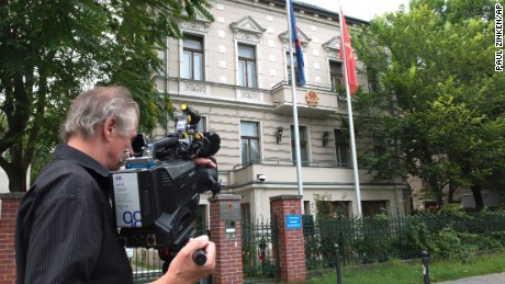 A  cameraman stands in front of the Vietnamese Embassy in Berlin on August 2.