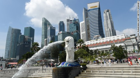 Singapore's famous Merlion (C) in front of the city's skyline in February, 2015.