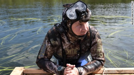 Putin takes a dip in a camouflage dive suit during his vacation this week in Siberia.