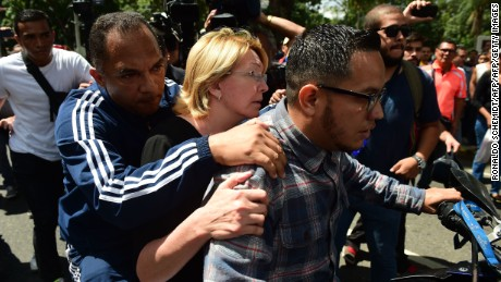 "Venezuela's chief prosecutor Luisa Ortega (C), one of President Nicolas Maduro's most vocal critics, is seen on a motorbike during a flash visit to the Public Prosecutor's office in Caracas on August 5, 2017 as national guard units were posted at the entries and exits to the building. Venezuela's dissident attorney general Ortega said Saturday her offices were ""under siege"" by troops, as a new loyalist assembly was about to start work to bolster the policies of President Nicolas Maduro and counter his foes. / AFP PHOTO / Ronaldo SCHEMIDT        (Photo credit should read RONALDO SCHEMIDT/AFP/Getty Images)"