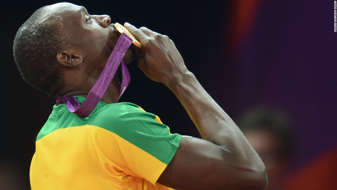 Bolt kisses his gold medal in 2012 after defending his Olympic title in the men's 200-meter. He also won the 100 again.