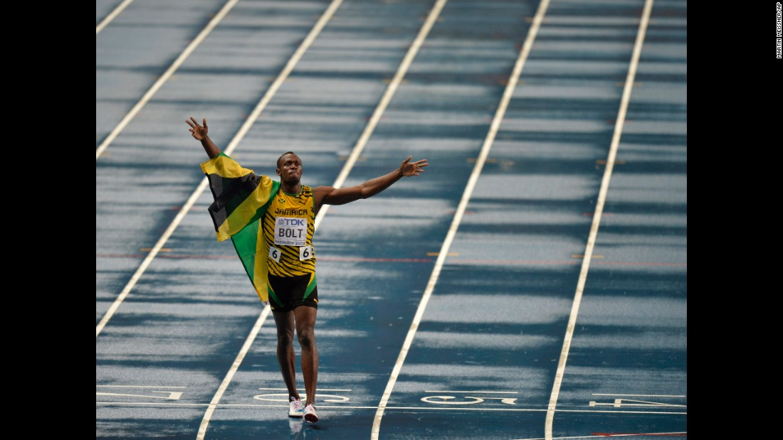 Bolt celebrates after winning 100-meter gold at the 2013 World Championships in Moscow.