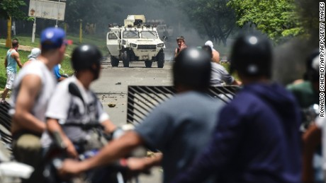 "Anti-government activists and the National Guard clash in Venezuela's third city, Valencia, on August 6, 2016, a day after a new assembly with supreme powers and loyal to President Nicolas Maduro started functioning in the country. In the video posted online earlier, allegedly at an army base used by the National Bolivarian Armed Forces in Valencia, a man presenting himself as an army captain declared a ""legitimate rebellion... to reject the murderous tyranny of Nicolas Maduro"" and demanded a transitional government and ""free elections."" After the video surfaced, military chiefs said troops had put down the ""terrorist"" attack.   / AFP PHOTO / RONALDO SCHEMIDTRONALDO SCHEMIDT/AFP/Getty Images"