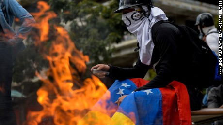 Opposition activists hold a protest against the newly inaugurated Constituent Assembly in Caracas on August 4, 2017. Venezuelan President Nicolas Maduro installed a powerful new assembly packed with his allies, dismissing an international outcry and opposition protests saying he is burying democracy in his crisis-hit country. / AFP PHOTO / FEDERICO PARRA        (Photo credit should read FEDERICO PARRA/AFP/Getty Images)