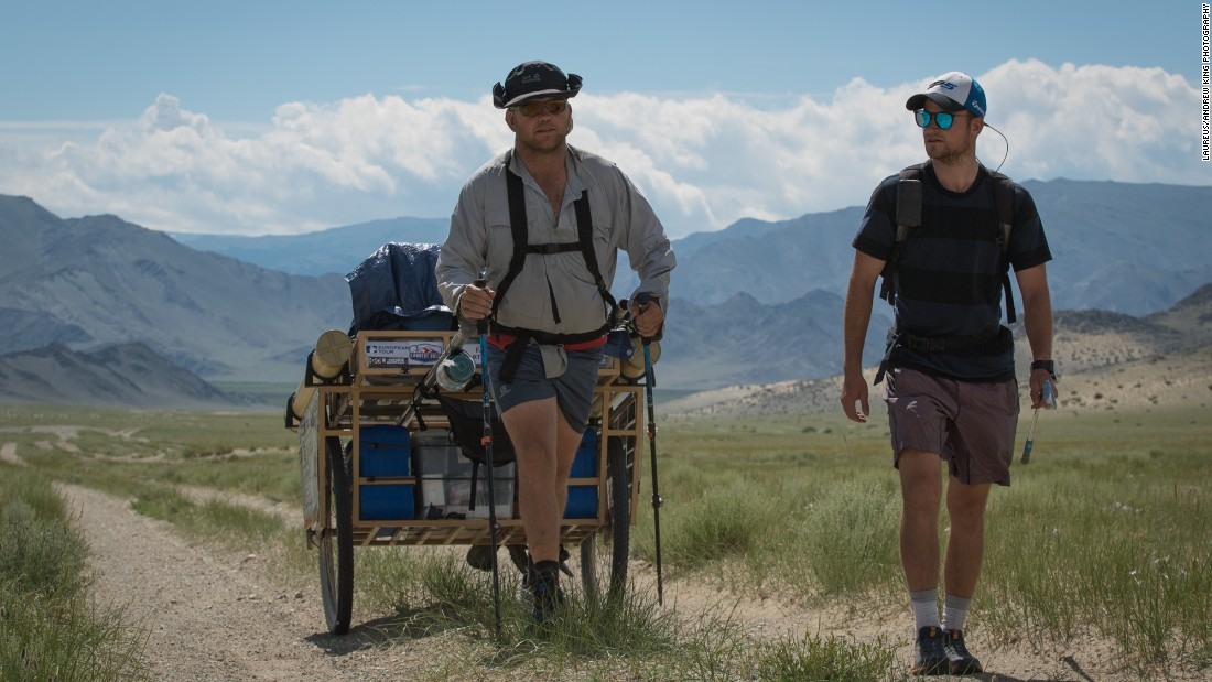 Amateur golfer Adam Rolston (right) and Ron Rutland, serving as his caddy, played the world's longest hole of golf across Mongolia. Rutland pulled a specially-designed cart with their supplies, while Rolston hit the shots.<br />