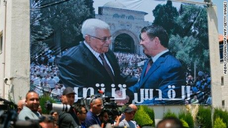 A photo montage of Jordan's King Abdullah II (R) and Palestinian president Mahmud Abbas (L) shaking hands in front of the Al-Aqsa mosque compound is seen on a building during a welcome ceremony of the Jordanian King in the West Bank city of Ramallah on August 7, 2017.  Jordan's King began a rare visit to the occupied West Bank to meet with Palestinain president, amid shared tensions with Israel over a flashpoint Jerusalem holy site. / AFP PHOTO / ABBAS MOMANI        (Photo credit should read ABBAS MOMANI/AFP/Getty Images)