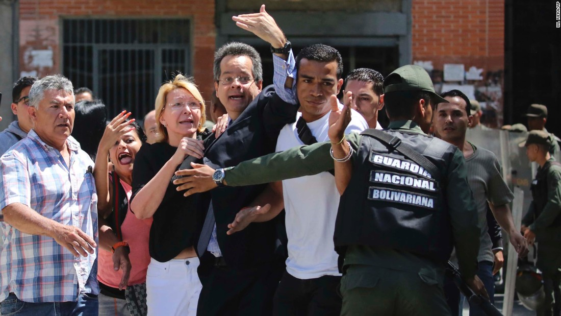 "Venezuela's Chief Prosecutor Luisa Ortega Diaz, third from left, is surrounded by employees of the General Prosecutor's office as she is <a href=""http://edition.cnn.com/2017/08/05/americas/venezuela-attorney-general/index.html"" target=""_blank"">barred by security forces from entering her office</a> in Caracas on Saturday, August 5."