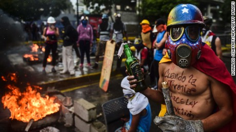 Opposition activists hold a protest against the newly inaugurated Constituent Assembly in Caracas on August 4, 2017.